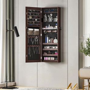 brown jewelry armoire in the room