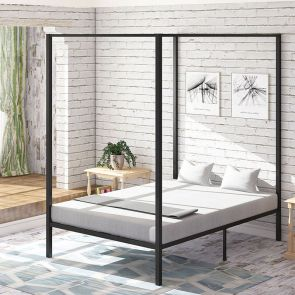full size canopy bed frame in the bedroom
