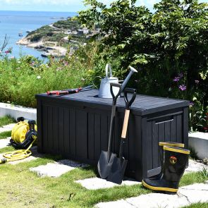 outdoor black large resin deck box in the garden