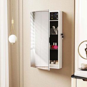 white jewelry armoire mirror in the room